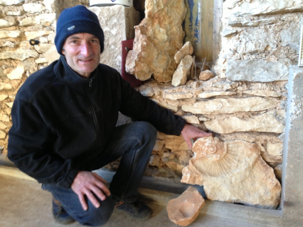 Eric with a myriad of 250 million old fossils he found while rototilling his land